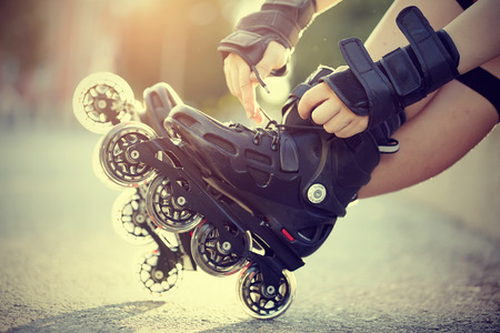 blading: Setting of laces on black roller skates