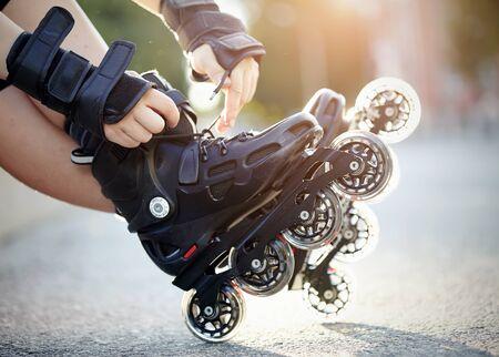 roller blade: Setting of laces on black roller skates