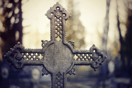 Sepulchral crosses at the cemetery in the evening.