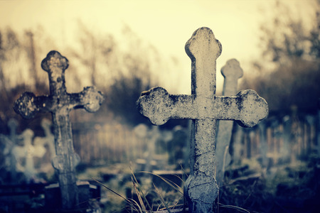 The old lop-sided sepulchral crosses on the thrown graves at the cemetery.