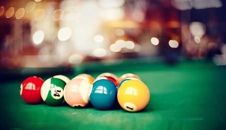 Colorful billiard balls on a green billiard table. Gambling game of Billiards.