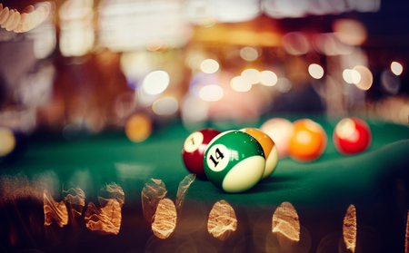 Billiard ball with number fourteen on a green billiard table. Gambling game of Billiards. Stok Fotoğraf