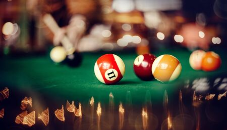 Colorful billiard balls on a green billiard table. Gambling game of Billiards. Archivio Fotografico - 126292102