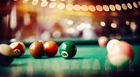 Colorful billiard balls on a green billiard table. Gambling game of Billiards. Billiard ball with number nine. 스톡 콘텐츠