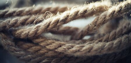 Rope close-up. Detail look of ropes texture as a background. Heavy duty rope.