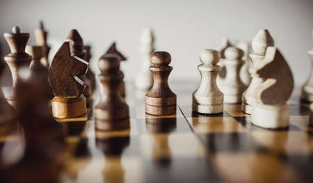 Wooden chess pieces on the chessboard. Intellectual game -chess. Chess pieces on the Board.