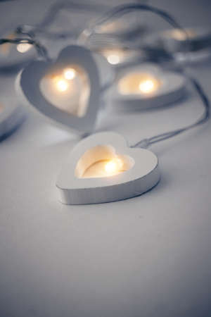 Luminous garland in the shape of hearts from LED bulbs. Valentine's Day. Love symbol. February 14. Winter holiday.