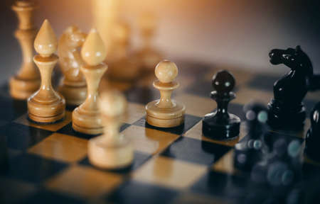 Wooden chess pieces on the chessboard. Intellectual game -chess. Chess pieces on the Board. A game of chess.