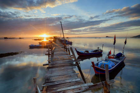 Sunrise view at fisherman jetty Jelutong, Penang Malaysia. Nature composition