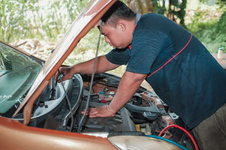 Segamat, Malaysia - November 11th , 2017 : Automobile air-conditioner servicing. Mechanic uninstall cooling coil and filter  in the old car.