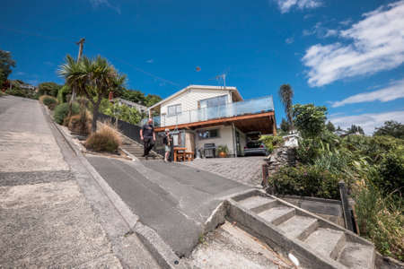 Dunedin, New Zealand A beautiful house built on Baldwin Street, the steepest street in the world (Dunedin, New Zealand - December 18th, 2017 : A beautiful house built on Baldwin Street, the steepest street in the world (Dunedin, New Zealand