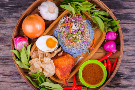Fried chicken with rice and a combination of vegetables, duck eggs and ingredients in the basket