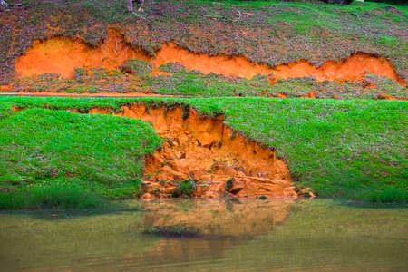Soil erosion or landslide on the lake in the rainy season at Muadzam Shah, Malaysia.