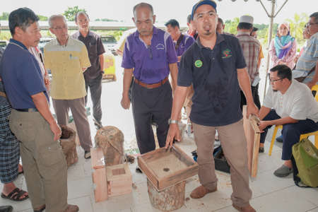 Muadzam Shah, Malaysia - March 1, 2018: The instructor explains the steps and how to install the topping  to participants of the Stingless Honey Production & Marketing Management Course