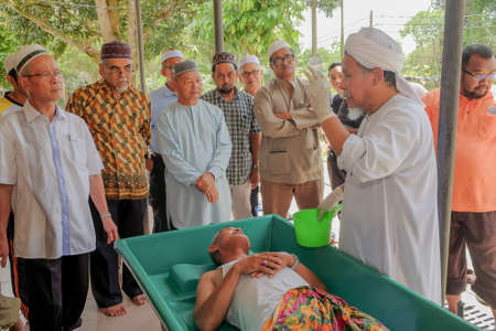 Muadzam Shah, Malaysia - March 11th, 2018: Instructors make the demonstration of the steps of bathing the corpses to prepare it for burial, in accordance with Islamic custom in the corpses management course Editorial