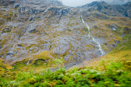 Beautiful view of waterfall before Homer tunnel on Milford Sound Highway, Fiordland national park, South Island, New Zealand.