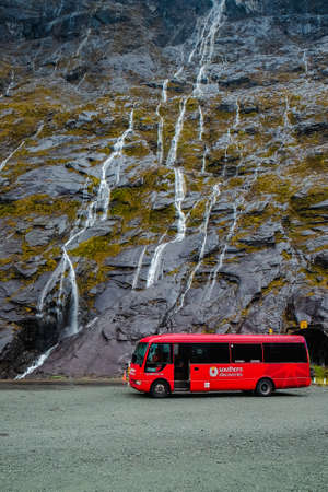 Fiordland, New Zealand – December 17th, 2017 :  Beautiful view of waterfall at entrance to Homer tunnel on Milford Sound Highway, Fiordland national park, South Island, New Zealand.
