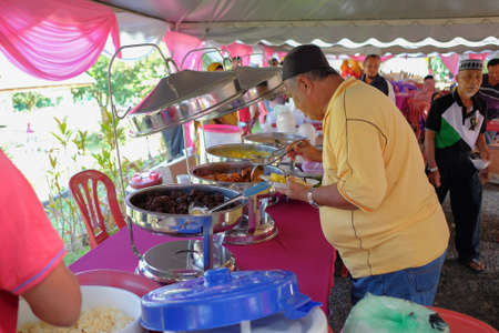 Muadzam Shah, Malaysia - March 24th, 2018 : View of buffet line at wedding ceremony in Malaysia. Selective focus applied. Editorial