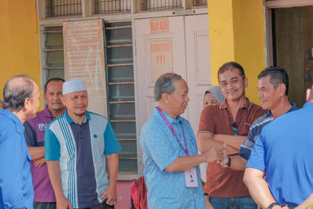 Muadzam Shah, Malaysia - May 9th, 2018: Malaysian voters line up to vote at the election center during the 2018 Malaysia General Election on May 9, 2018, in Muadzam Shah, Malaysia. Editorial