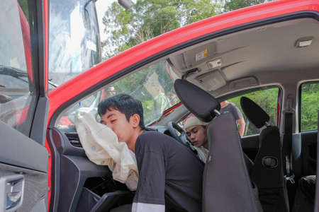 Muadzam Shah, Pahang - October 18th, 2018 : Driver and passanger injuries after the accident during the Inter Agency Disaster Training Program 2018 Editorial