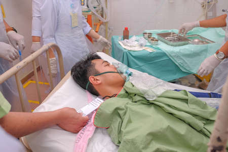 Muadzam Shah, Pahang - October 18th, 2018 : A female doctor who is examining male patients lying on the patient's bed during road accidents in  Inter Agency Disaster Training Program 写真素材 - 120680829