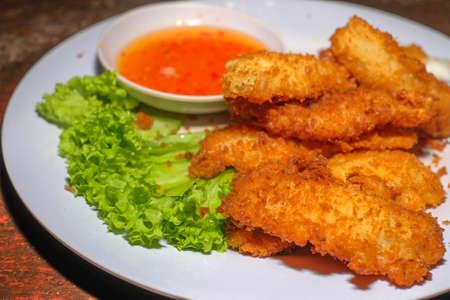 Deep fried squids with sauce Фото со стока