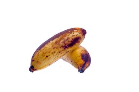 Over ripe bananas isolated on white background.