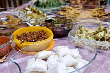 Kuah Kacang or  peanut sauce, chicken satay, Ketupat Daun Palas or malay rice dumpling, lemang, rendang  and fermented sticky rice. Traditional Malay food, Eid Fitr dish. Malaysian cuisine.