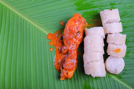 Malay lemang served with rendang ayam.Famous traditional Malay foods during Ramadhan, Eid Fitr and Eid Adha