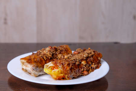 Popia- Malaysian traditional dessert, filed with bean sprouts, nuts and chili sauce.