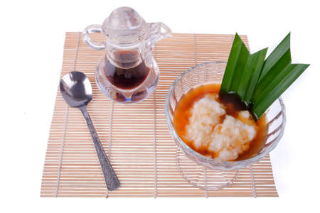 Bubur Sumsum isolated on white background. Bubur Sumsum is Javanese dessert porridge of rice flour, coconut milk and served with palm sugar syrup.