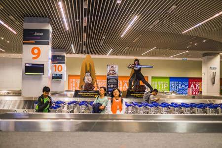 Sepang, Malaysia - Disember 21st, 2017 : Baggage pick up area at an airport on Airport baggage conveyorin Kuala Lumpur International Airport.