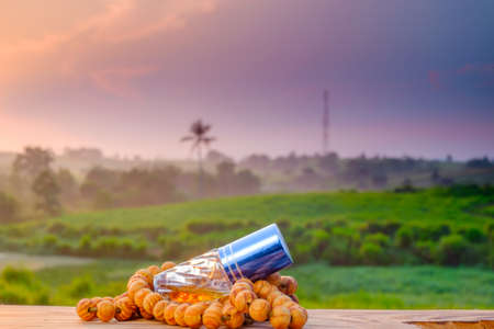 Ramadan kareem concept with rosary, and perfume on old wood with beautiful sunrise  as background Foto de archivo