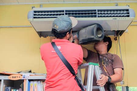 Muadzam Shah, Malaysia - May 15th, 2019 : Air conditioning technicians checking,repairing and maintenance aircond service at Kolej Vokasional Muadzam Shah, Malaysia.