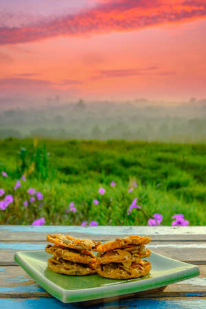 Florentine cookies  on wooden table over blurred image of beautiful scenery. Banque d'images