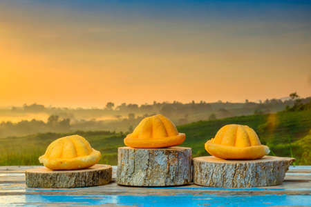 Malaysia traditional sweet as known as Baulu or Bahulu, make from eggs, sugar and fluor  during beautiful sunrise.