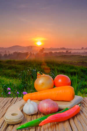 Group of vegetables on cutting board in beautiful sunrise