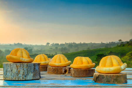 Malaysia traditional sweet as known as Baulu or Bahulu, make from eggs, sugar and fluor during beautiful sunrise. Stock Photo
