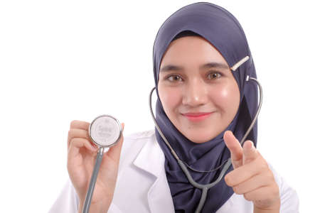 Beautiful Muslimah doctor holding a stethoscope isolated in white background Stock Photo