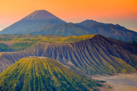 The beautiful sunrise at Mount Bromo volcano, the magnificent view of Mt. Bromo located in Bromo Tengger Semeru National Park, East Java, Indonesia.Image contains noise grain and blurry.