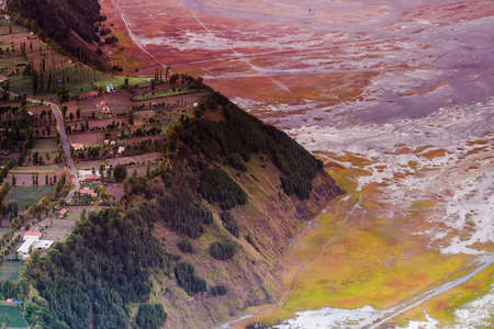Beautiful sunrise view of Cemoro Lawang village the land of mist at Mount Bromo in Bromo Tengger Semeru National Park, East Java, Indonesia . Image contains noise grain and blurry.