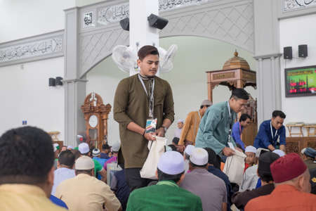 Muadzam Shah, Malaysia - August 24th, 2019 : Muslim  officer  collect donations during  the religious talk by Ustaz Adzhar Idrus in Dhuha at  Bandar Satelit mosque. He is a famous preacher in Malaysia