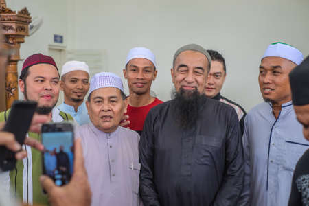 Muadzam Shah, Malaysia - August 24th, 2019 :Muslim people shake hands after the religious talk by Ustaz Adzhar Idrus in Duha time at Bandar Satelit mosque. He is a famous preacher in Malaysia Editorial