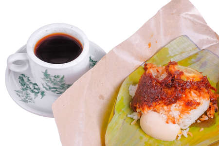 Nasi Lemak or Spicy Rice . Nasi lemak is a traditional Malay rice cooked in coconut milk with pandan leaf .  Wrapped in banana leaf with spicy chili sambal,fried anchovies,egg.cucumber slice and peanut