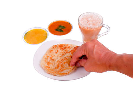Tea with milk, Roti canai or Roti Parata , dalca and curry sauce on the plate isolated on white background