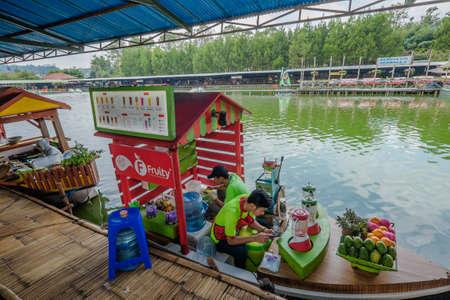 Lembang, Bandung, Indonesia - November 30th, 2019 : Indonesian seller in floating market in Lembang, Bandung, Indonesia Editorial