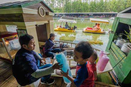 Lembang, Bandung, Indonesia - November 30th, 2019 : Indonesian seller and tourist  in floating market in Lembang, Bandung, Indonesia