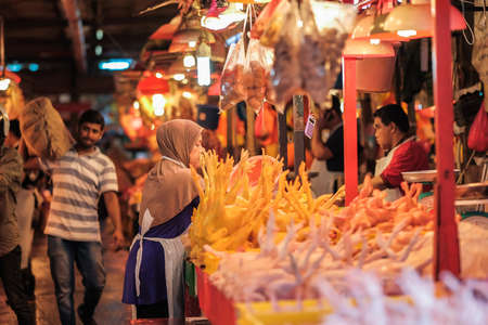 Kuala Lumpur, Malaysia - December 2nd, 2019 :  A Muslim vendor selling a halal fresh chicken at a stall at the wet market in the morning .