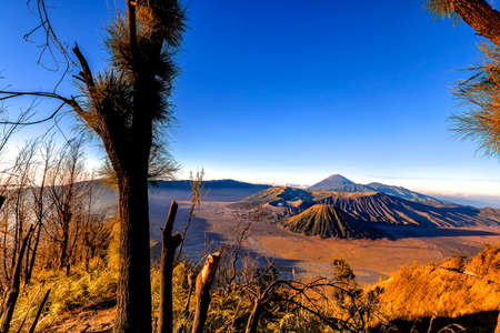 Mount Bromo volcano during sunrise from viewpoint. Mount Bromo is an active volcano and one of the most visited tourist attractions in East Java, Indonesia. 