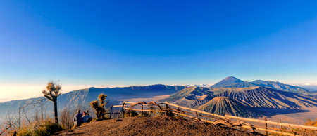 Panorama Bromo . Mount Bromo volcano during sunrise from viewpoint. Mount Bromo is an active volcano and one of the most visited tourist attractions in East Java, Indonesia. KK